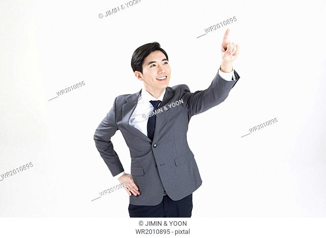 a man in a suit pointing up