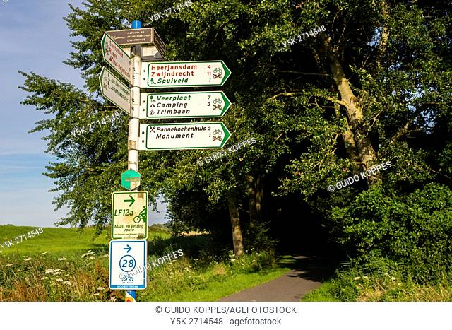 Barendrecht, Netherlands. Signpost with directions at nature reserve Oude Maas River