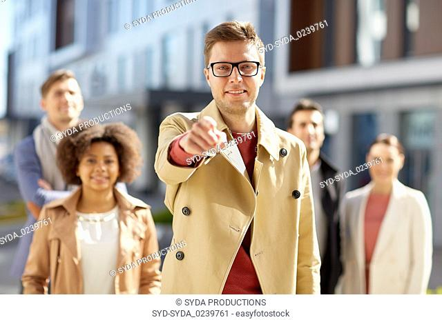 businessman pointing finger over people on street