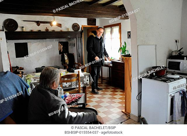 Reportage on a rural pharmacy technician during his home delivery round in Auxi-le-Château, France. Visting a patient who is hospitalized at home