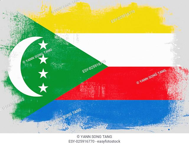 Flag of Comoros painted with brush on solid background