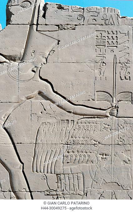 Karnak, Luxor, Egypt. Temple of Karnak sacred to god Amon: the king Tuthmosis III and the won enemies
