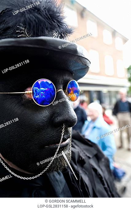 England, Kent, Rochester. A member of Wolf's Head and Vixen Border Morris at the annual Sweeps Festival in Medway