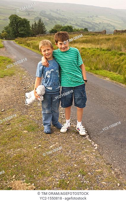 Two brothers walking in Swaledale in North Yorkshire , England , Britain , Uk