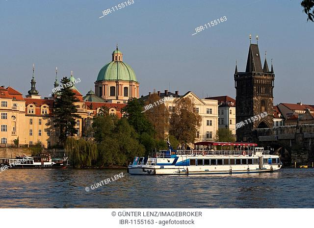 Cityscape with Moldava, Charles bridge and St. Francis church, Prague, Czech Republic, Europe