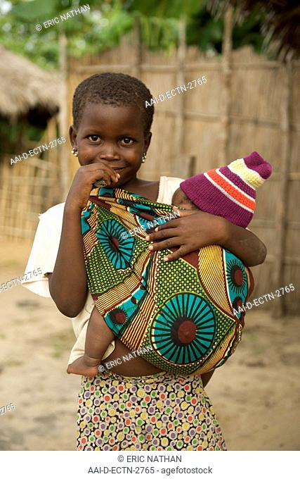 Child carrying baby in Guludo village in the Quirimbas National Park in northern Mozambique