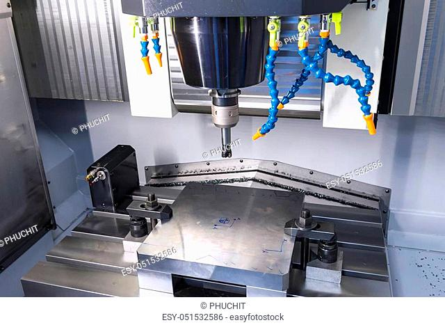 The CNC machine while prepare cutting sample work piece. The Vertiacal Milling CNC machine with indexable cutting tool and sample work piece