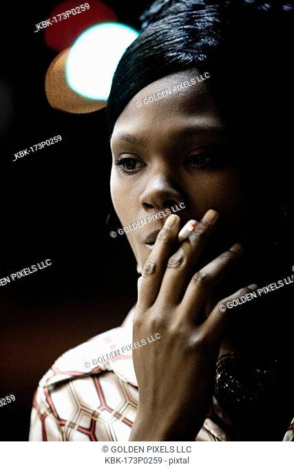 Close-up of a woman smoking a cigarette