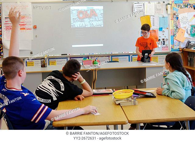 Student Giving Report Synching iPad, Wellsville, New York, USA