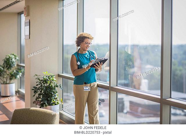 African American doctor using digital tablet