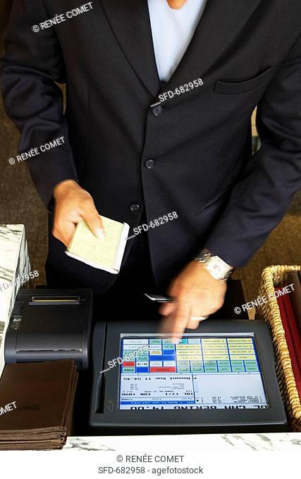 Waiter Calculating Bill at Register, Blue Duck Restaurant