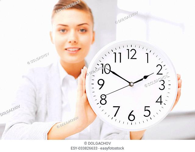 business, office, school and education concept -attractive businesswoman showing clock