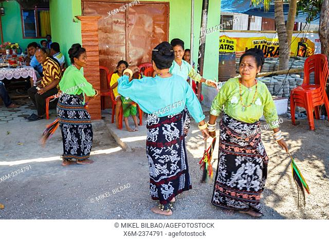 Women dancing in a wedding celebration. Maumere. Flores island. Indonesia, Asia