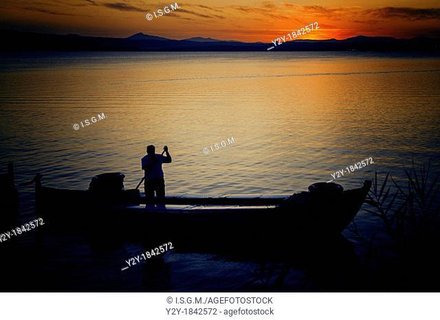 Boatman at sunset in Albufera Lake, Valencia, Spain