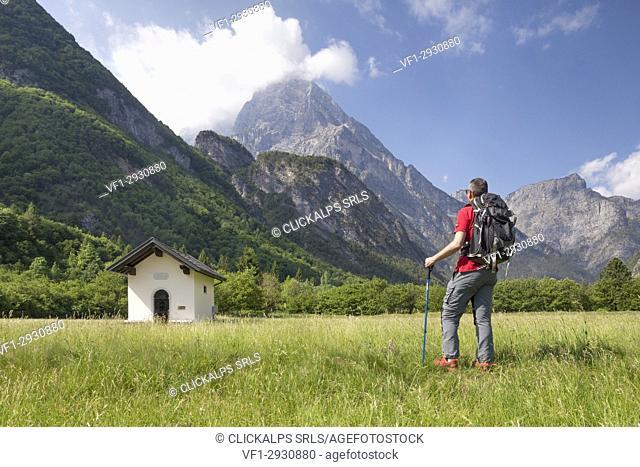 Hiker near a little church along the Val Cimoliana road, Cimolais, Pordenone, Friuli Venezia Giulia, Italy, Europe