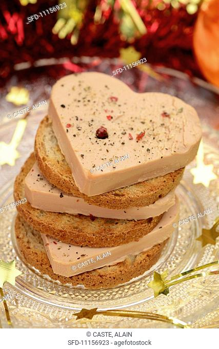 A stack of foie gras and toasted slices of bread