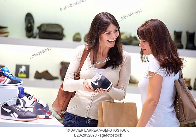 Women sisters 35 and 40 years shopping at a shoe store. Donostia. San Sebastian. Gipuzkoa. Basque Country- Spain