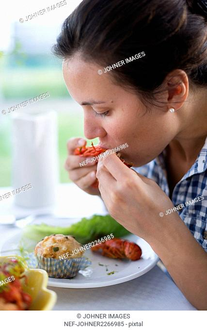 Woman eating shrimps