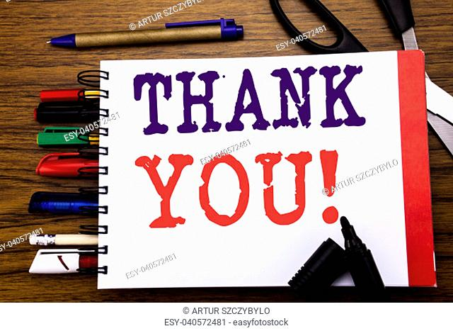 Handwriting Announcement text showing Thank You. Business concept for Thanks Message Written on notebook, wooden background office equipment like pens scissors...