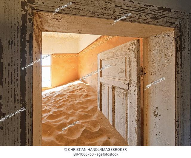 Interior of house ruins filled with sand in Kolmanskop, Namibia, Africa