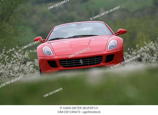 Ferrari 599 GTB, model year 2006-, red, driving, frontal view, country road, landsapprox.e