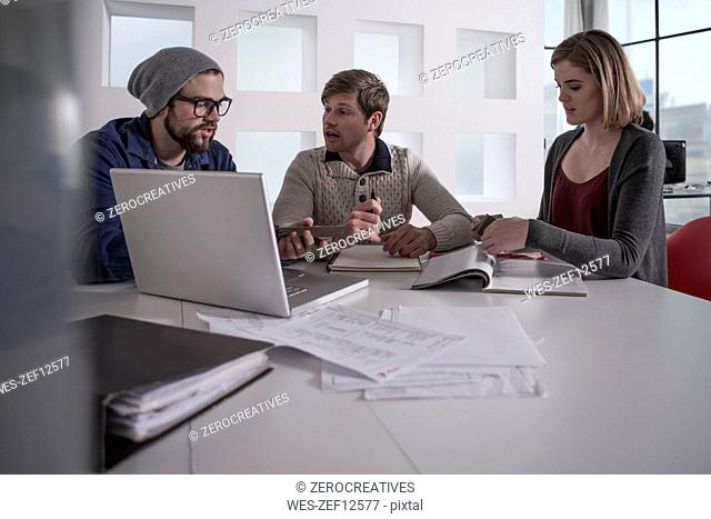 Colleagues in office having an informal meeting