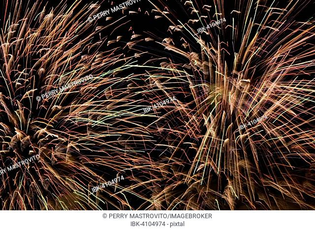Red, orange, green and purple fireworks in the night sky, Montreal, Quebec, Canada