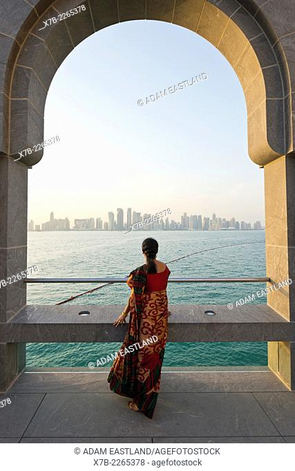 Doha. Qatar. Vistitor looking across Bay of Doha from the Museum of Islamic Art