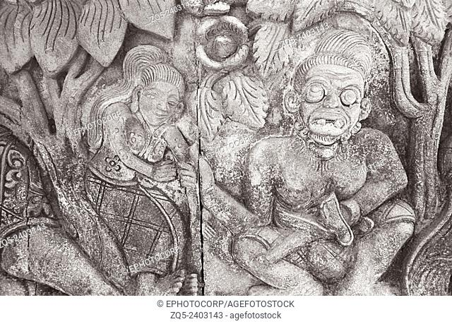 Singaraja temple, lady in the forest on the left and on the right is the depiction of Demi God. Bali Indonesia