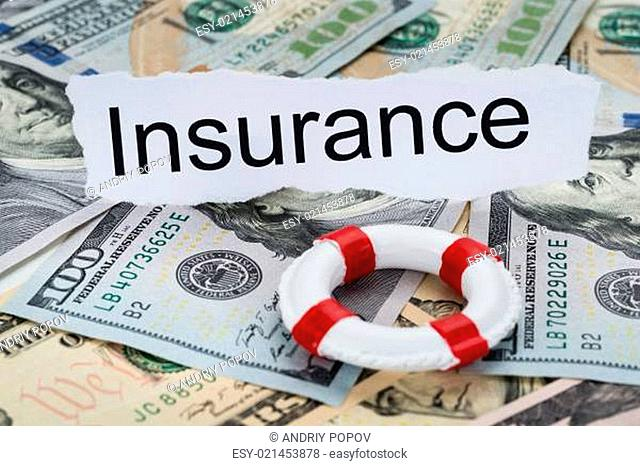 Insurance Text On Piece Of Paper With Banknotes