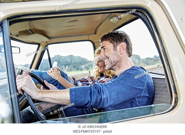 Smiling couple in pick up truck