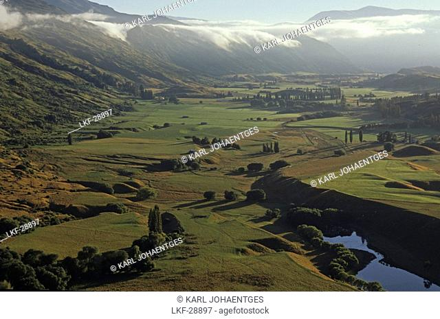 View from Coronet Peak onto river valley in the sunlight, Central Otago, South Island, New Zealand, Oceania