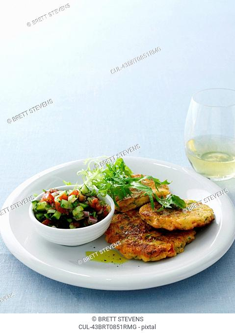 Plate of fish cakes and salad