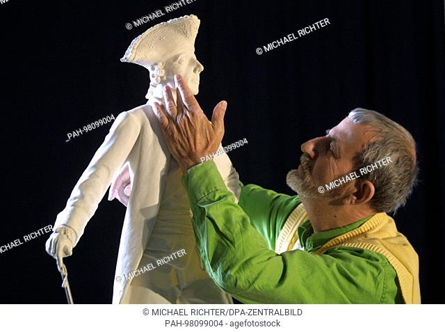 Using a few photos and a picture of the death mask, Armenian sculptor Spartak Babayan shapes the plaster model for a replica of the memorial to Frederick II