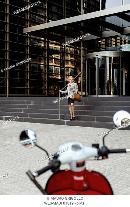 Senior businesswoman leaving office building