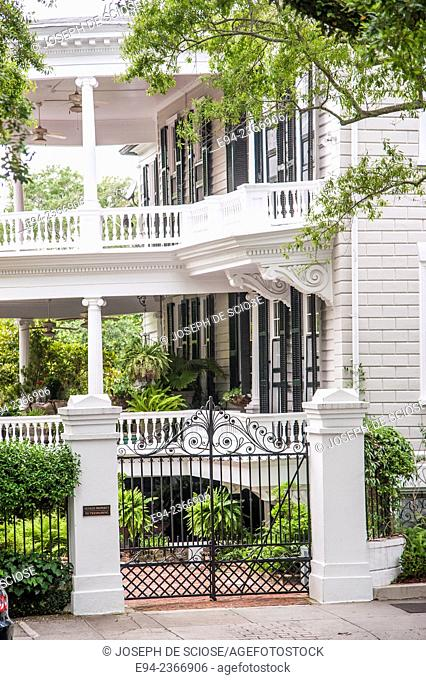 Historic home in Charleston South Carolina with an iron gate in the foreground