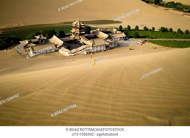 The picturesque temple by the Mingsha sand dunes in Dunhuang, Gansu, China