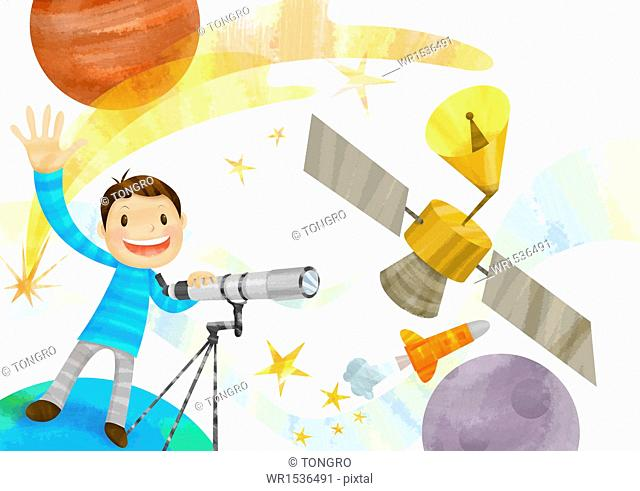 a boy playing with astronomy equipment