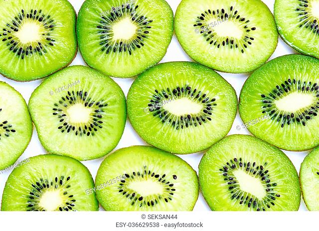 Many slices of kiwi fruit on white background