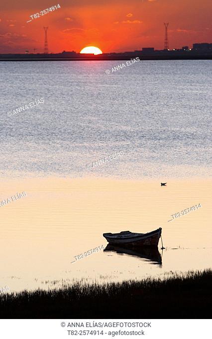 sunset with small boat in Puerto de Santa Maria, Cadiz, Andalucia, Spain, Europe