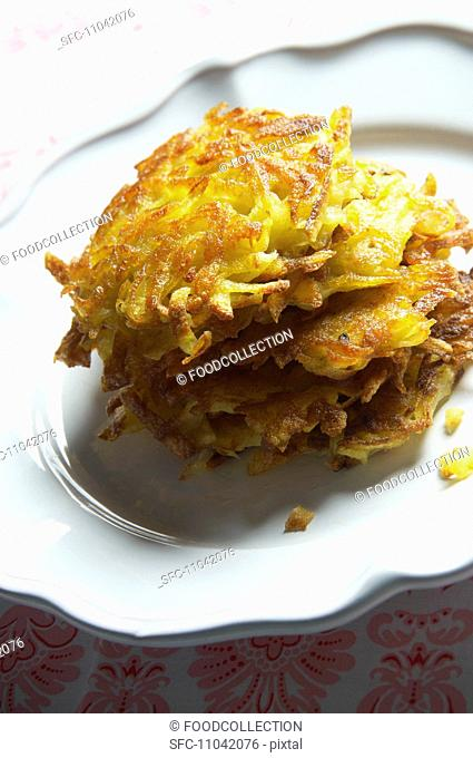 A stack of potato rösti hash browns on a plate