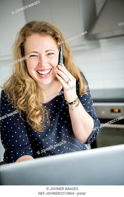 Happy woman using cell phone