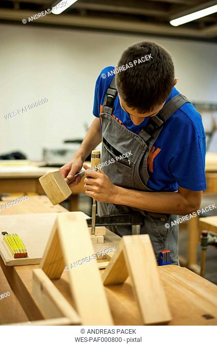 Vocational school student working in a carpenter's workshop