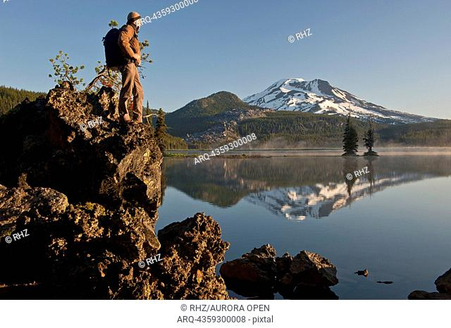 Man with backpack hiking, Sparks Lake in the morning