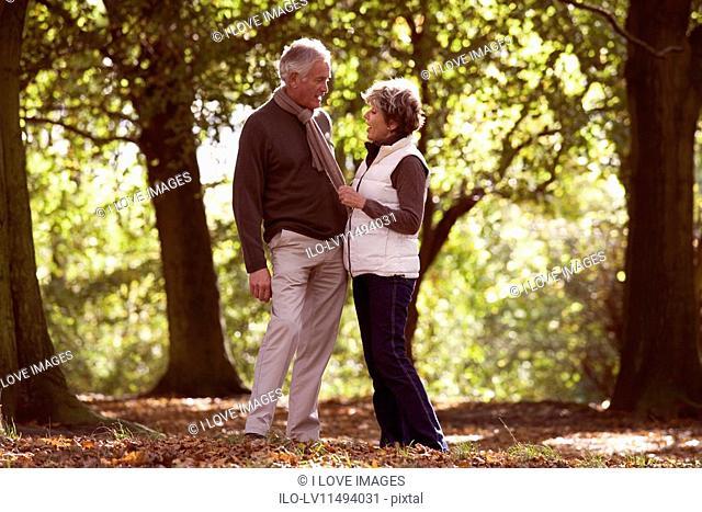 A senior couple in autumn time