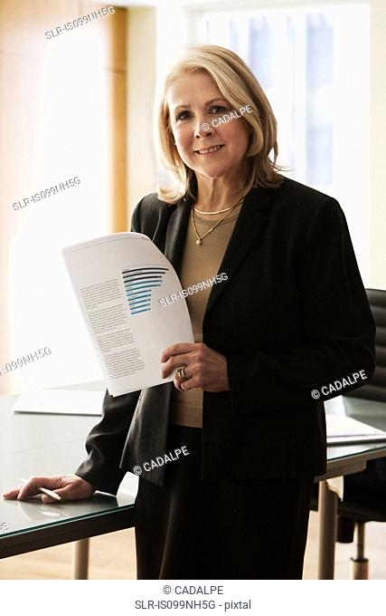 Mature businesswoman in office, portrait