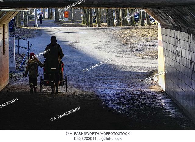 Stockholm, Sweden A woman walking her children to school in the Jakobsberg Centrum, a residential suburban hub northwest of the city