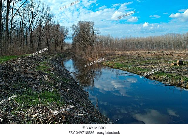 Irrigation canal during early spring, landscape view