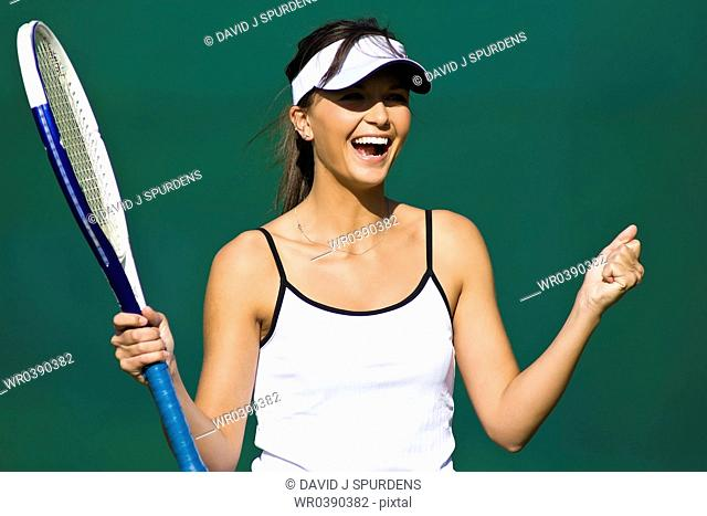 Tennis player smiles on court