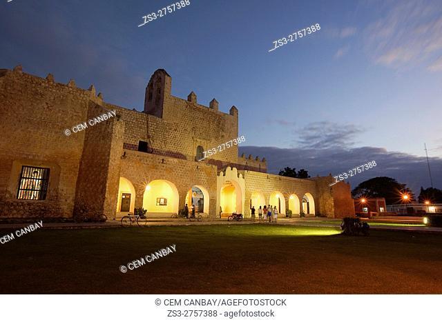 Tourists in front of the Templo de San Bernardino y Convento de Sisal by night, Valladolid, Yucatan Province, Mexico, Central America